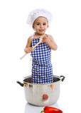 Dziecko szefa kuchni mienia pozycja w garnku i miarka Zdjęcie Stock