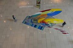 Dziecko sztuka z dalej malujący podłoga Zdjęcie Stock