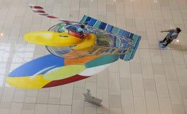 Dziecko sztuka z dalej malujący podłoga Obrazy Royalty Free