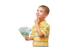 dziecko trzyma pieniądze Obrazy Royalty Free