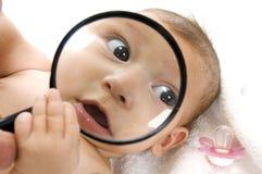 dziecko twarz powiększający s Obrazy Stock