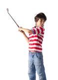 Dziecko używa kij golfowy pozycję na bielu zdjęcia royalty free