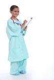 Dziecko w lekarki szoruje zdjęcie stock