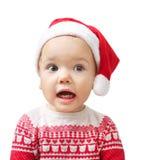 Dziecko w Santa kapeluszowym i czerwonym boże narodzenie kostiumu odizolowywającym Zdjęcie Stock