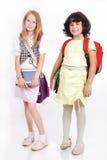 Dziecko w wieku szkolnym z torbami i książkami odizolowywającymi fotografia stock