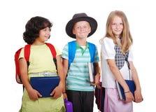 Dziecko w wieku szkolnym z torbami i książkami, odosobnionymi fotografia royalty free
