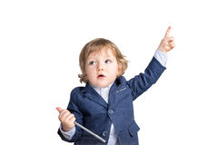 Dziecko wskazuje upwards z piórem fotografia royalty free