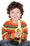 dziecko z bananami jedzenie Zdjęcia Stock