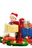 Dziecko z boże narodzenie prezentami Fotografia Stock