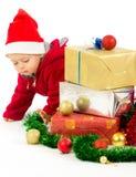 Dziecko z boże narodzenie prezentami Zdjęcia Royalty Free