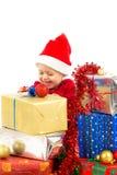 Dziecko z boże narodzenie prezentami Obrazy Royalty Free