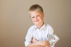 Dziecko z pieniądze (dolary) obraz royalty free