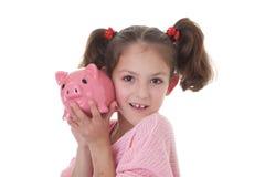 Dziecko z prosiątko banka pieniądze pudełkiem Fotografia Stock