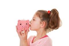 Dziecko z prosiątko bankiem Zdjęcia Royalty Free