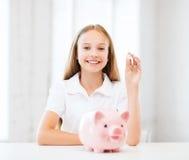 Dziecko z prosiątko bankiem Obraz Royalty Free