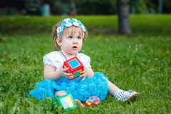 Dziecko z zabawkami Obrazy Royalty Free