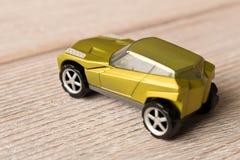 Dziecko zabawkarski samochód na drewnianym stole z bliska zdjęcie royalty free