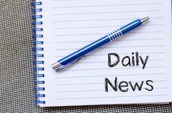 Dzienny wiadomości pojęcie na notatniku Fotografia Stock