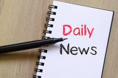Dzienny wiadomości pojęcie na notatniku Zdjęcia Stock