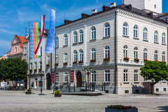 Dzierzoniow - a city in southwestern Poland. Dzierzoniow, Poland - June 13, 2015: Dzierzionow  town in Lower Silesia.View of the town hall, before which hoisted Stock Photography