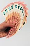 Dziesięć euro banknotów w ręce ilustracja wektor