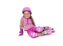 dziewczyn łyżwy małe odpoczynkowe rolkowe Zdjęcie Royalty Free