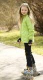 dziewczyn łyżwy szczęśliwe małe rolkowe Obrazy Royalty Free