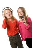 dziewczyn hełmofonów mały mikrofon dwa Zdjęcie Royalty Free