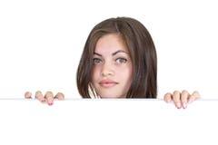 Dziewczyn zerknięcia out od ekranu za Zdjęcie Stock