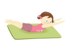Dziewczyna ćwiczy na macie Fotografia Stock