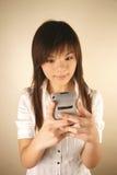 dziewczyna azjatykci komórki używane Fotografia Stock