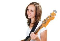Dziewczyna bawić się basową gitarę odizolowywającą na bielu Obrazy Royalty Free