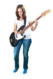 Dziewczyna bawić się basową gitarę odizolowywającą na bielu Fotografia Royalty Free