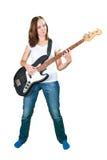 Dziewczyna bawić się basową gitarę odizolowywającą na bielu Zdjęcia Royalty Free