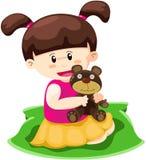 Dziewczyna bawić się lalę na biel Zdjęcia Royalty Free