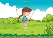Dziewczyna bawić się skokową arkanę przy wierzchołkiem wzgórze ilustracja wektor