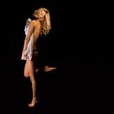 Dziewczyna bawić się suknię krył i kusi Zdjęcia Royalty Free