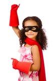 Dziewczyna bawić się super bohatera Obrazy Royalty Free