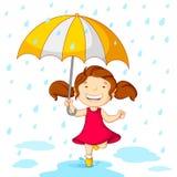 Dziewczyna bawić się w Deszczu Obrazy Stock
