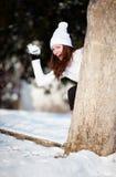 Dziewczyna bawić się z śniegiem Obraz Royalty Free