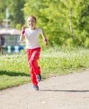 dziewczyna bieg mały parkowy Obrazy Royalty Free