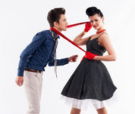 Dziewczyna ciągnie eleganckiego mężczyzna w rocznika kostiumu Zdjęcia Royalty Free
