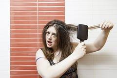 dziewczyna grzebieniowa Fotografia Stock