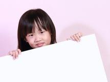 Dziewczyna i biała deska Fotografia Royalty Free