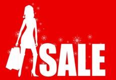 Dziewczyna i bożych narodzeń sprzedaż na czerwonym tle Zdjęcia Royalty Free