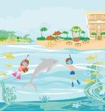 Dziewczyna i chłopiec nurkujemy z delfinem Zdjęcie Stock
