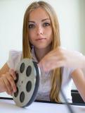 Dziewczyna i film Zdjęcia Stock