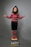 Dziewczyna i książki Zdjęcia Royalty Free