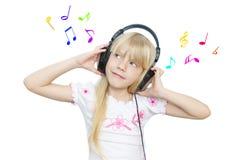 Dziewczyna i muzyka Zdjęcia Royalty Free