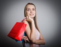 Dziewczyna i papierowe torby Zdjęcia Stock